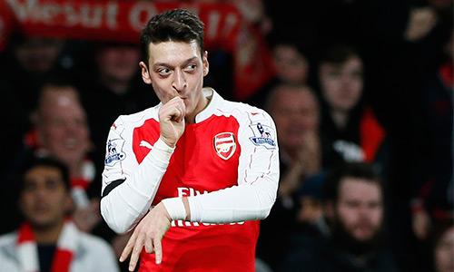 Ozil được kỳ vọng trở thành đầu tàu đưa Arsenal tới ngôi vương Ngoại hạng Anh sau 11 năm. Ảnh: Reuters.